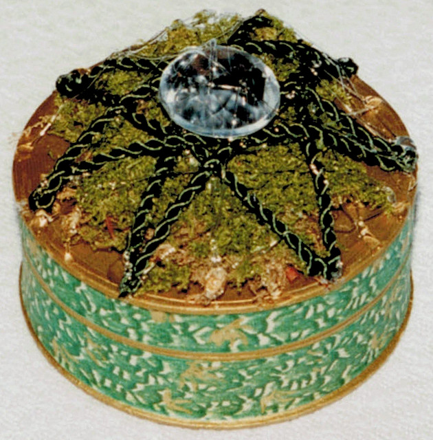 vintage pharmacy box with cord star over moss, rhinestone