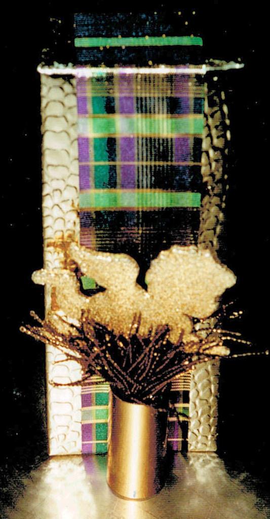 flat ribbon on golden box, perfume bottle lid with gold.tassel & angel sticker