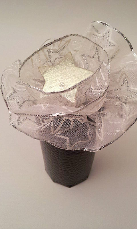 round box with silver rosette