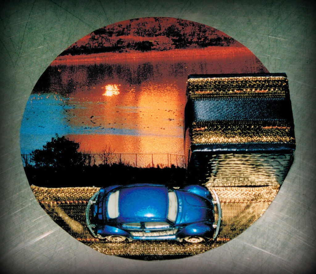 `trip into the sunset´  - box & `Beetle´ on cardboard tray covered with magazine page